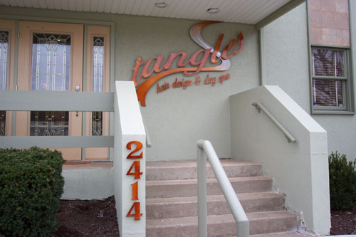 Tangles Hair Design and Day Spa Signage at entrance